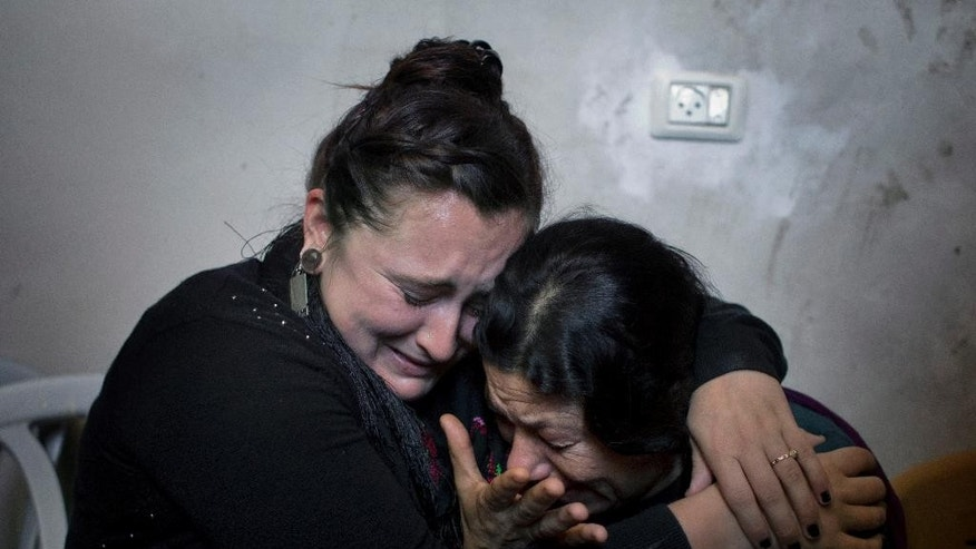 Two Palestinian women mourn during the funeral of Moataz Zawahara, who was killed in clashes with Israeli troops, at the family house in Deheisha refugee camp, near the West Bank city of Bethlehem, Wednesday, Oct. 14, 2015. (AP Photo/Nasser Nasser)