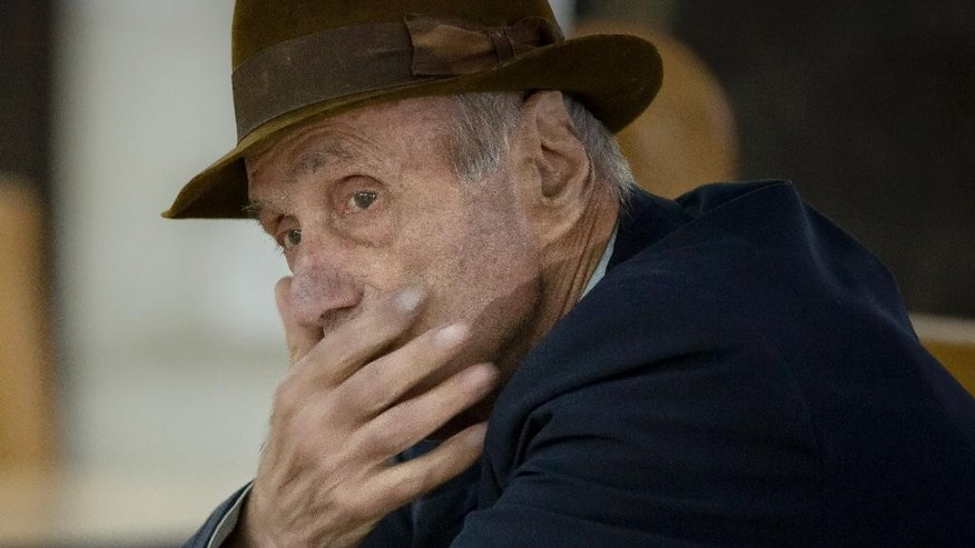 Former communist prison commander Alexandru Visinescu waits for the start of the hearing in his appeal at the High Court for Cassation and Justice in Bucharest, Romania, Wednesday, Oct. 14, 2015. Visinescu, commander of the Ramnicu Sarat prison from 1956 to 1963, was convicted, in the first such trial in Romania, to 20 years in jail for the deaths of 12 political prisoners during his command. The hearing was quickly adjourned because Visinescu did not have a lawyer. (AP Photo/Vadim Ghirda)