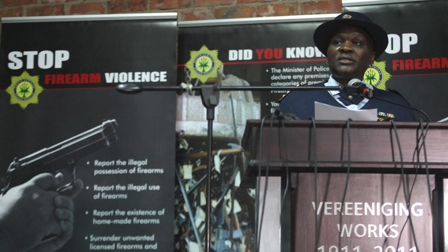 In this photo taken Thursday, July 9, 2015 national police commissioner Riah Phiyega delivers a speech at an event where confiscated weapons were smelted at a metal processing plant in Vereeniging, South Africa. Phiyega will remain on suspension with full pay until the board of inquiry into her fitness to hold office has completed its work, the presidency said Wednesday, Oct. 14 2015.(AP Photo/Denis Farrell)