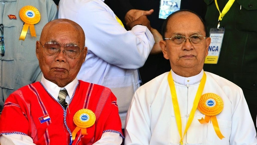 "Myanmar President Thein Sein, right, sits along with Mutu Say Po, chairman of Karen National Union (KNU), for a group photo session during the signing ceremony of ""Nationwide Ceasefire Agreement"" Thursday, Oct. 15, 2015, in Naypyitaw, Myanmar. Myanmar's government and eight smaller ethnic rebel armies signed the cease-fire agreement to end more than six decades of fighting, but other more powerful groups refused to come on board, signaling that peace will remain elusive for some time to come. (AP Photo/Aung Shine Oo)"