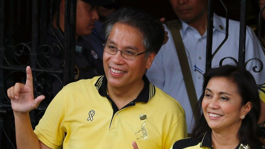 "Former Interior and Local Government Secretary and now a presidential candidate Mar Roxas, left, and running mate Maria Leonor ""Leni"" Robredo flash the ""L"" sign for ""Laban"" meaning Fight! after filing their certificates of candidacy for next year's presidential elections  Thursday, Oct. 15, 2015 in Manila, Philippines. Roxas and Robredo are the candidates of the ruling Liberal Party. (AP Photo/Bullit Marquez)"