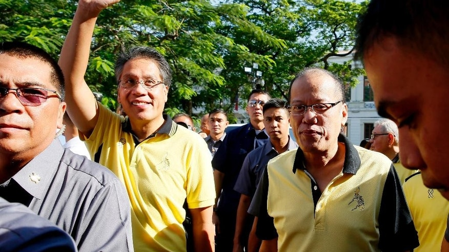 "Former Interior and Local Government Secretary and now a presidential candidate Mar Roxas waves to supporters as he arrives with Philippine President Benigno Aquino III to file his certificate of candidacy for next year's presidential elections at the Commission on Elections Thursday, Oct. 15, 2015 in Manila, Philippines. Roxas and running mate Maria Leonor ""Leni"" Robredo are the candidates of the ruling Liberal Party. (AP Photo/Bullit Marquez)"