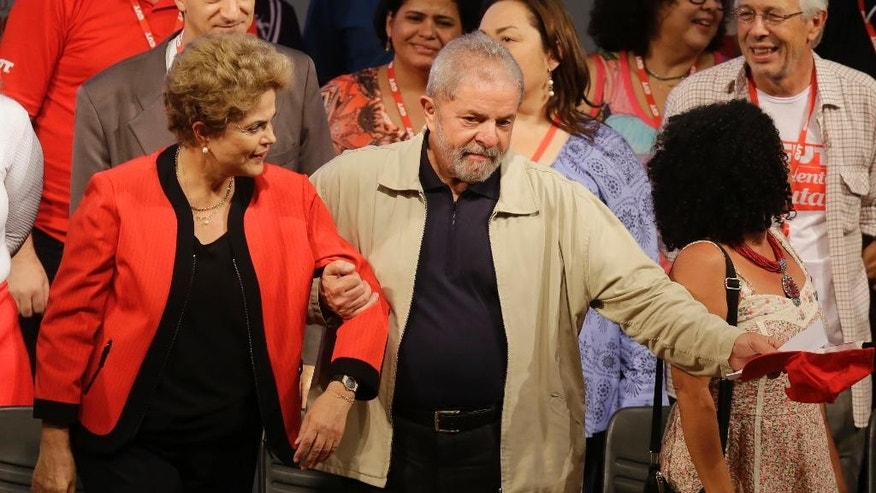 Brazil's former President Luiz Inacio Lula da Silva, right, and current President Dilma Rousseff attend the Central Workers Union annual convention in Sao Paulo, Brazil, Tuesday, Oct. 13, 2015. (AP Photo/Nelson Antoine)