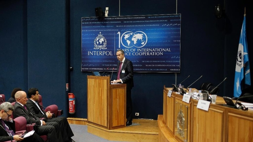 Wil Van Gemert, Europol's Deputy Director for Operations, delivers a speech during a conference at the Interpol headquarters in Lyon, central France, Thursday, Oct. 15, 2015. The operations chief for Europe's top law enforcement agency says established organized crime networks are drawing up new connections as they jump into the business of smuggling migrants hoping for a better life. (AP Photo/Laurent Cipriani)