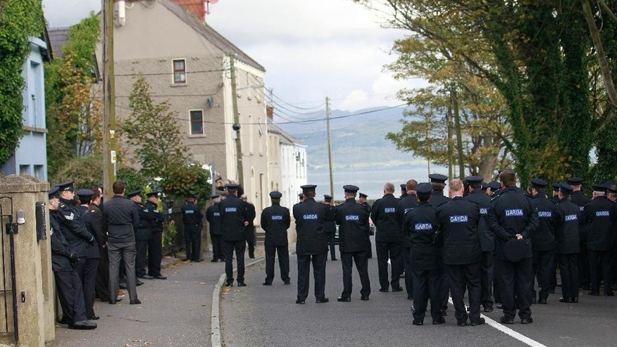 Irish police listen to the funeral service of policeman Tony Golden during his state funeral at St Oliver Plunkett Church, Blackrock, Ireland, Thursday, Oct. 15, 2015.  The police officer was gunned down Sunday as he responded to a domestic despite involving a dissident republican and his partner.  (AP Photo/Peter Morrison)