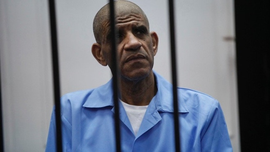 May 25, 2014: Abdullah al-Senussi , ex-spy chief in Muammar Gaddafi's government, sits behind bars during a hearing at a courtroom in Tripoli.