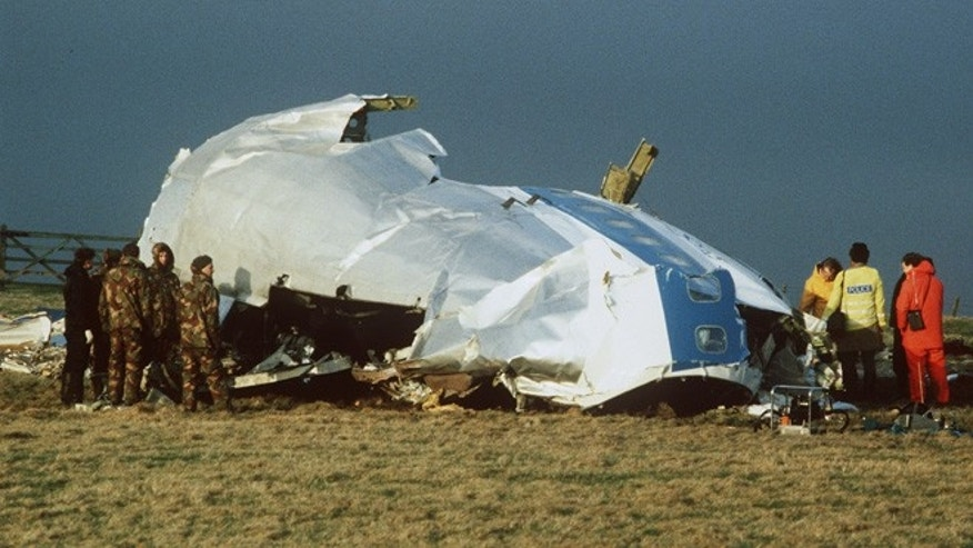 1998: Scottish rescue workers and crash investigators search a farmer's field east of Lockerbie Scotland after a mid-air bombing killed all 259 passengers and crew, and 11 people on the ground.