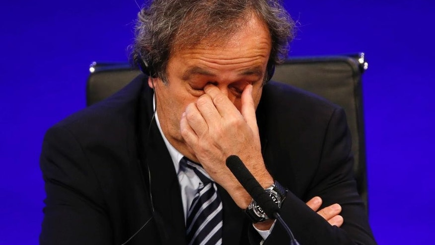 FILE - In this May 24, 2013 file photo UEFA President Michel Platini reacts as he speaks to members of the media at the end of the 37th Ordinary UEFA Congress in London. UEFA leaders were meeting Thursday Oct. 15, 2015 to decide whether to continue backing Michel Platini, with some not yet satisfied by his explanation for a payment that led to his 90-day FIFA suspension. (AP Photo/Sang Tan)