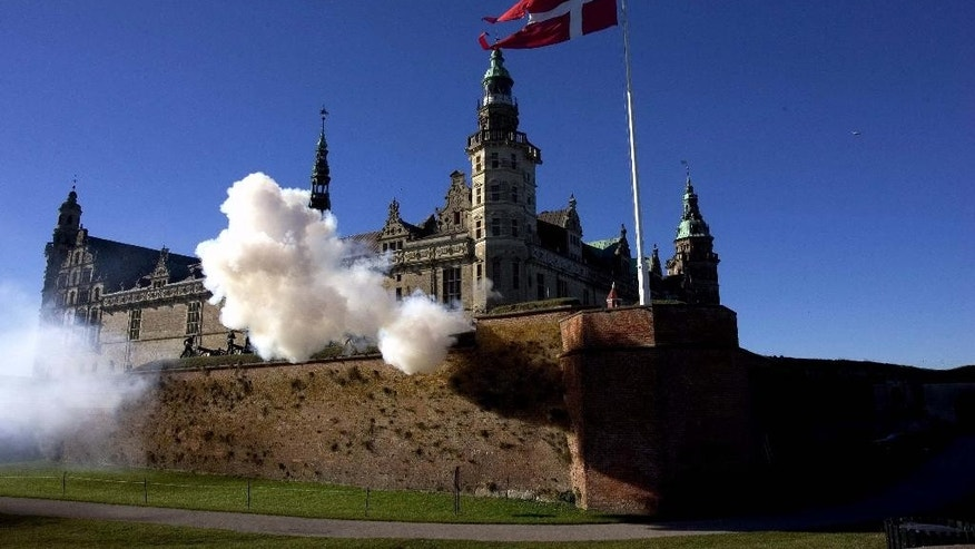 "FILE - A Saturday Oct. 15, 2005 photo from files of a 21 canon salute at Kronborg Castle in Helsingoer, about 50 kms (30 miles) north of Copenhagen, Denmark, made famous as Elsinore in Shakespeare's play ""Hamlet"". Danes were excited this week to see their calm and prosperous country thrust into the U.S. presidential race as Democratic hopefuls Bernie Sanders and Hillary Clinton sparred over whether there's something Americans can learn from Denmark's social model. (Kim Agersten/Polfoto via AP, File)  DENMARK OUT"