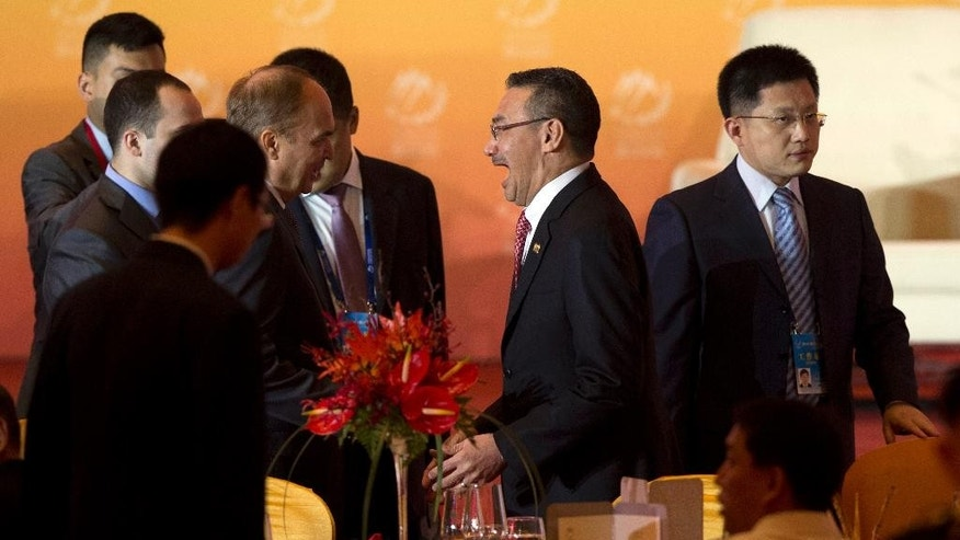 Malaysian Defence Minister Hishammuddin Hussein, second right, attends the welcome banquet of the 6th Xiangshan Forum at which analysts, military leaders and others from around the globe will discuss Asian-Pacific security, maritime issues and anti-terrorism in Beijing, Friday, Oct. 16, 2015. China vastly expanded the scope of the Xiangshan Forum last year, making it an annual rather than biennial event and boosting participation to more than 300 defense officials and academics from 47 countries. (AP Photo/Ng Han Guan)