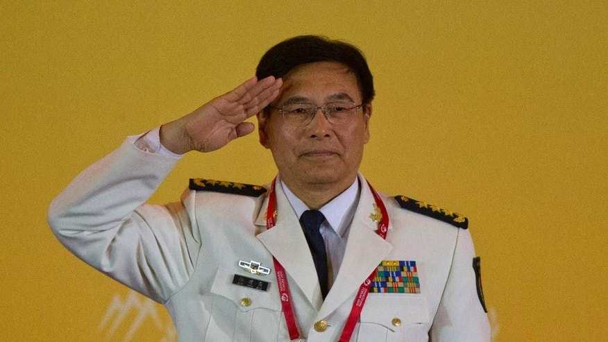 Admiral Sun Jianguo, Chairman of China Institute for International Strategic Studies, salutes before speaking at the welcome banquet of the 6th Xiangshan Forum at which analysts, military leaders and others from around the globe will discuss Asian-Pacific security, maritime issues and anti-terrorism in Beijing, Friday, Oct. 16, 2015. China vastly expanded the scope of the Xiangshan Forum last year, making it an annual rather than biennial event and boosting participation to more than 300 defense officials and academics from 47 countries. (AP Photo/Ng Han Guan)