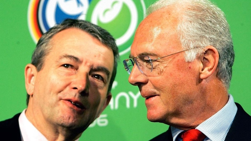 FILE - In this March 6, 2006 file photo German soccer legend and head of the organizing committee for the 2006 soccer World Cup in Germany, Franz Beckenbauer, right, talks to Wolfgang Niersbach during a workshop in the build up for the World Cup in Düsseldorf, western Germany.  (AP Photo/Frank Augstein, file)