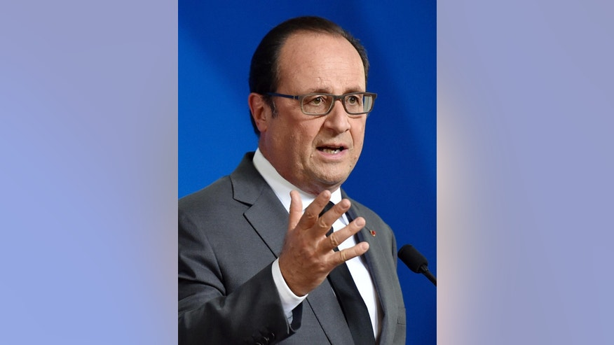 French President Francois Hollande talks to the media at a press conference after the EU summit in Brussels, Belgium on early Friday, Oct. 16, 2015. European Union heads of state met to discuss, among other issues, the current migration crisis. (AP Photo/Martin Meissner)