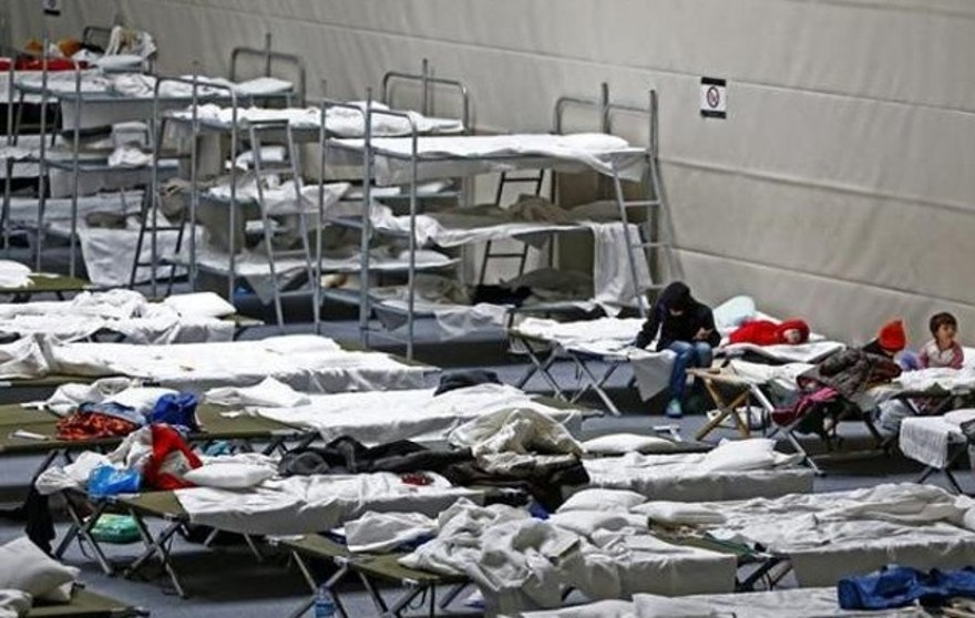 Refugees rest on beds at an improvised temporary shelter in a sports hall in Hanau, Germany, last month. (Reuters)