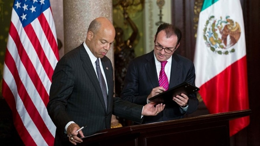 "U.S. Homeland Security Secretary Jeh Johnson, left, and Mexican Treasury Secretary Luis Videgaray, sign bilateral agreements press conference in Mexico City,Thursday, Oct. 15, 2015. The United States and Mexico launched a pilot air cargo pre-inspection program that aims to facilitate trade between the two nations. Johnson said that the program ""represents a remarkable evolution"" of the bilateral relationship. (AP Photo/Eduardo Verdugo)"