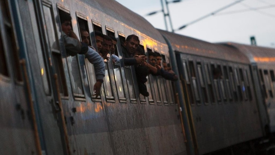 Migrants are seen on a train at the railway station in Zakany, 230 kms southwest of Budapest, Hungary, Friday, Oct. 16, 2015 after they crossed the Hungarian-Croatian green border. Hungary will close its green border to Croatia at midnight. (Gyorgy Varga/MTI via AP)