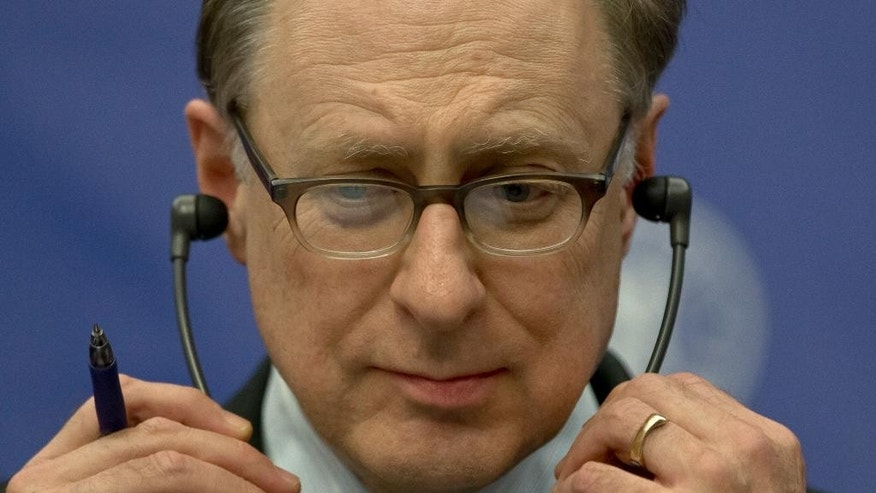 In this picture taken Thursday, Oct. 15, 2015, NATO Deputy Secretary-General Alexander Vershbow adjusts his headphones in Bucharest, Romania. Vershbow said Friday, Oct. 16, that Russia is more interested in shocking and intimidating rather than building a predictable relationship with the military alliance. (AP Photo/Vadim Ghirda)