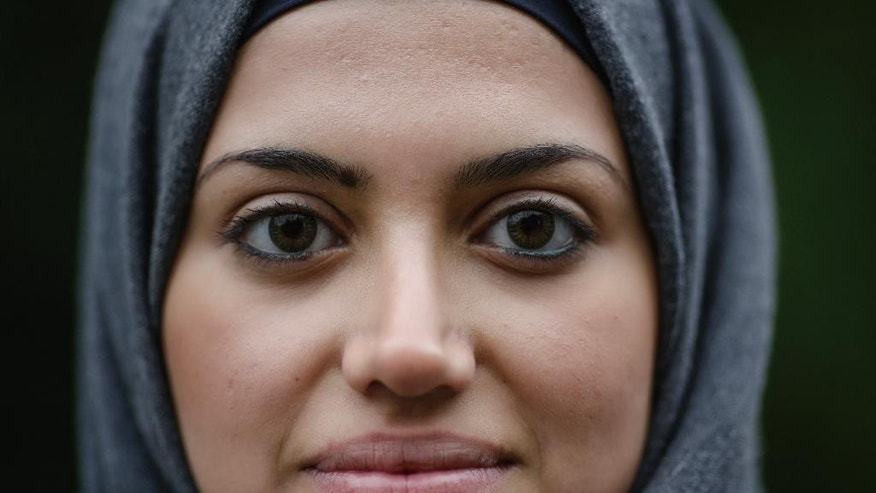 In this Tuesday, Oct. 13, 2015 photo Syrian refugee Reem Habashieh poses for a photo during an interview with the Associated Press at a park in Pirna, Germany. (AP Photo/Markus Schreiber)