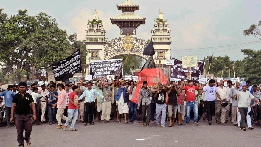 "FILE - In this Wednesday, Oct. 14, 2015 file photo, activists of Nepal's ethnic Madhesi group protest against the new constitution at Birganj, a town on the border with India, Nepal. A New York-based human rights group has urged Nepal to investigate the dozens of deaths during protests by ethnic groups against the country's new constitution. Human Rights Watch said in a report released Friday, October 16, that at least 45 people have died in the protests that began in August and that the violence included ""extrajudicial killings by the police against protesters, killing of children and murders of police officers. (AP Photo/Aftab Alam Siddiqui, File)"