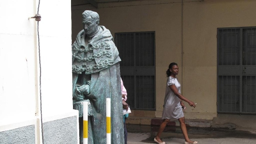 In this photo taken Friday, Oct. 9 2015, a statue of Antonio Salazar, a Portuguese dictator in colonial times, faces a wall in a courtyard of the national library in Maputo, the capital of Mozambique. Mozambique got rid of many statues, street names and other symbols of colonial rule after independence from Portugal in 1975. (AP Photo/Christopher Torchia)