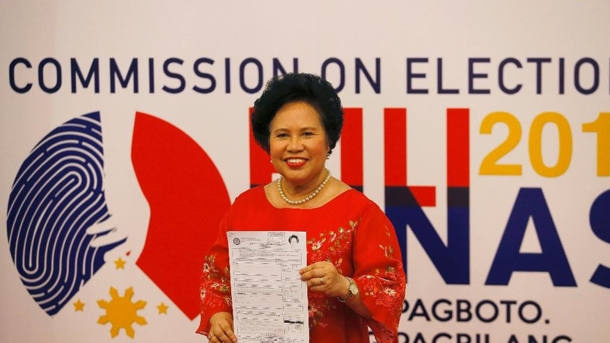 In this Friday, Oct. 16, 2015 photo, Sen. Miriam Santiago displays her certificate of candidacy shortly after filing as a presidential candidate for next year's presidential elections in Manila, Philippines. Santiago is one of at least four major contenders to have emerged in next year's presidential race in the Philippines after a weeklong registration of candidates closed Friday. (AP Photo/Bullit Marquez)
