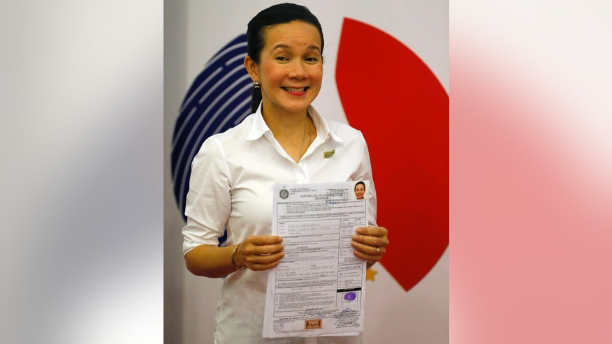 In this Thursday, Oct. 15, 2015 photo, Sen. Grace Poe displays her certificate of candidacy shortly after filing as a presidential candidate for next year's presidential elections in Manila, Philippines. Poe is one of at least four major contenders to have emerged in next year's presidential race in the Philippines after a weeklong registration of candidates closed Friday. (AP Photo/Bullit Marquez)