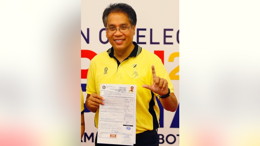 In this Thursday, Oct. 15, 2015, former Interior Secretary Mar Roxas displays his certificate of candidacy shortly after filing as a presidential candidate for next year's presidential elections in Manila, Philippines. Roxas is one of at least four major contenders to have emerged in next year's presidential race in the Philippines after a weeklong registration of candidates closed Friday. (AP Photo/Bullit Marquez)