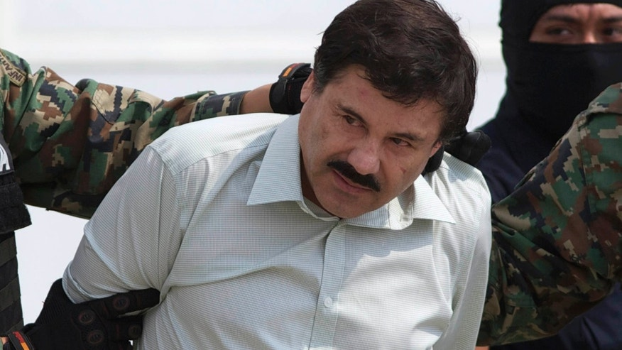 "FILE - This Feb. 22, 2014 file photo shows Joaquin ""El Chapo"" Guzman, the head of Mexico's Sinaloa Cartel, being escorted to a helicopter in Mexico City following his capture overnight in the beach resort town of Mazatlan."