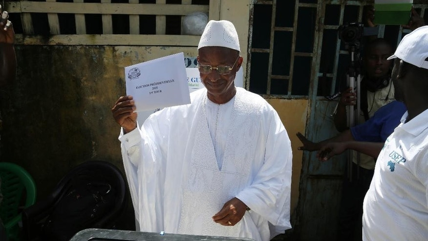 FILE - In this file photo taken Sunday Oct. 11, 2015, Guinean opposition presidential candidate Cellou Dalein Diallo, of the UFDG party, prepares to cast his vote during presidential elections in the Bambeto neighbourhood of Conakry, Guinea. Guinea's President Alpha Conde could win another term in office after clinching a lead in partial results from Sunday's election, according to the election commission. (AP Photo/Youssouf Bah, File)