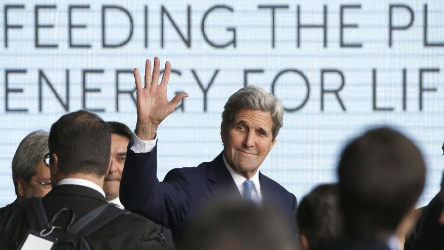 US Secretary of State John Kerry waves as he arrives at the Expo World's Fair taking place in Milan, Italy, Saturday, Oct. 17, 2015.  (AP Photo/Luca Bruno)