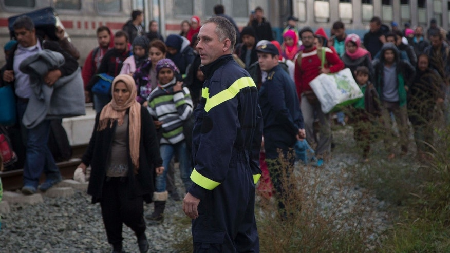 Oct. 16, 2015: People disembark from a train in Botovo, on the Croatia-Hungary border.