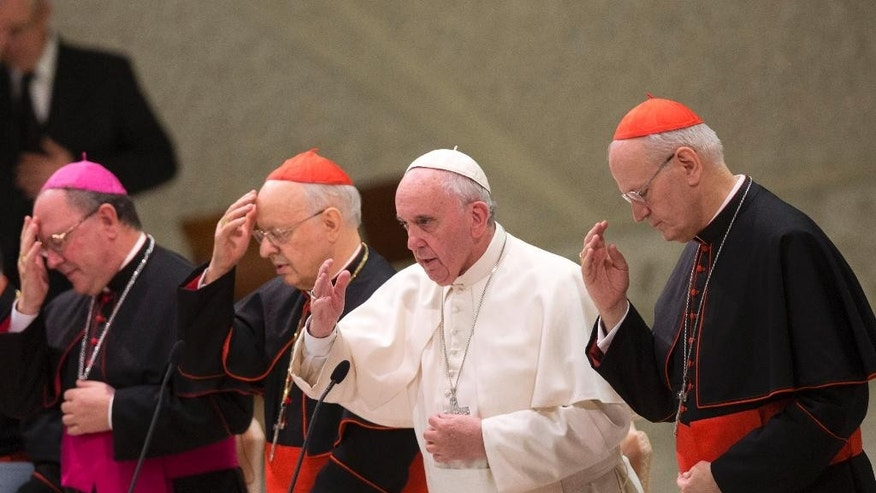 Pope Francis, second from right, delivers his blessing during a meeting marking the 50th anniversary of the creation of the Synod of Bishops, in the Paul VI hall at the Vatican, Saturday, Oct. 17, 2015. (AP Photo/Alessandra Tarantino)