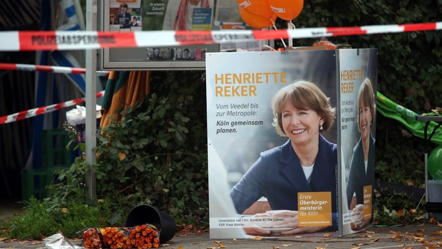 Oct. 17, 2015: Election posters of independent candidate for the mayor of Cologne Henriette Reker stand behind a police barrier in Cologne, Germany..