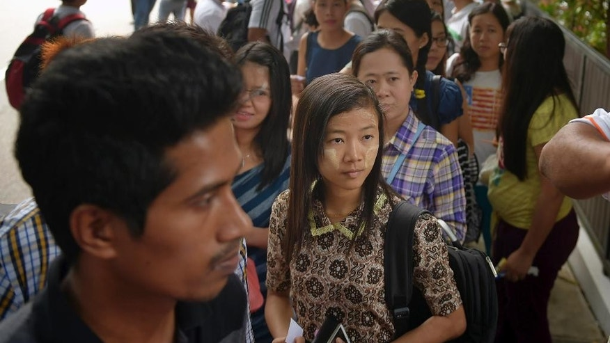 Myanmar citizens wait for their turn outside the Myanmar Embassy in Singapore to cast advance ballots in the country's Nov. 8 parliamentary election, on Sunday, Oct. 18, 2015. The large turnout has overwhelmed the embassy staff, prompting officials to extend voting that was supposed to end Sunday by three days. (AP Photo/Joseph Nair)