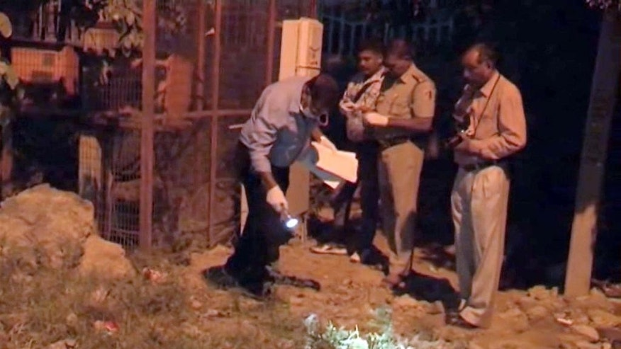 Oct. 17, 2015: In this image made from video, police collect evidence in the playground where an alleged rape of a two-year-old girl took place in New Delhi.