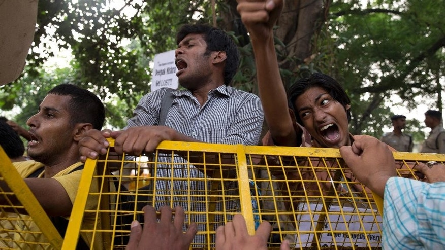 Indian students shout slogans during a protest against the latest incidents of rape in New Delhi, India, Sunday, Oct. 18, 2015. Police arrested two teenagers Sunday for allegedly raping a toddler in New Delhi, in the latest incident of sexual violence against a young child in the Indian capital. In a separate incident, police on Saturday arrested three men for raping a 5-year-old in an east Delhi suburb.(AP Photo /Tsering Topgyal)