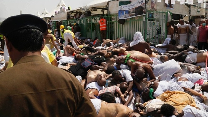 Sept. 24, 2015: Muslim pilgrims and first responders gather around bodies of people crushed in Mina, Saudi Arabia during the annual hajj pilgrimage.