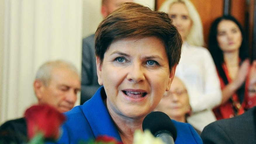 Poland's main opposition Law and Justice party candidate for the prime minister's post, Beata Szydlo speaks to supporters during a campaign meeting in Warsaw, Poland, Saturday, Oct. 17, 2015,  ahead of the Oct. 25 parliamentary elections in Poland. (AP Photo/Alik Keplicz)