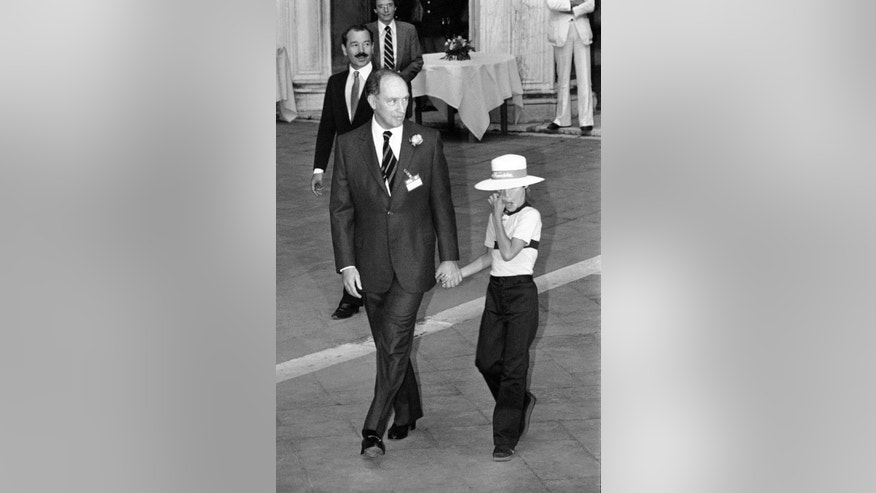 FILE - In this 1980 file photo, Canadian Prime Minister Pierre Trudeau holds his 8-year-old son Justin by the hand as both enter the Venice Doge's Palace to attend the evening reception given to the delegations attending the World Economic Summit, in Venice, Italy. On Monday, Oct. 19, 2015, Canadian voters reclaimed their country's liberal identity sending Justin Trudeau to the prime minister's office and ending 10 years of conservative leadership under Stephen Harper. At 43, he becomes the second youngest prime minister in Canadian history. (AP Photo/File)