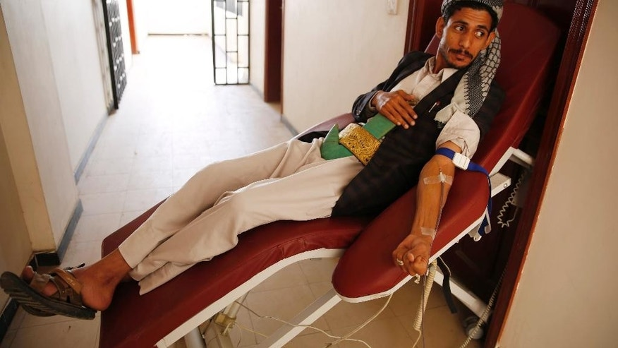 A Yemeni man donates blood for the victims of airstrikes by the Saudi-led coalition, at a school in Sanaa, Yemen, Sunday, Oct. 18, 2015. (AP Photo/Hani Mohammed)