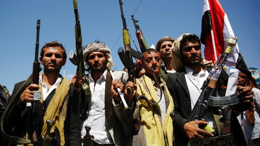 Shiite fighters, known as Houthis, hold their weapons during a demonstration against the Saudi-led coalition in Sanaa, Yemen, Sunday, Oct. 18, 2015. (AP Photo/Hani Mohammed)