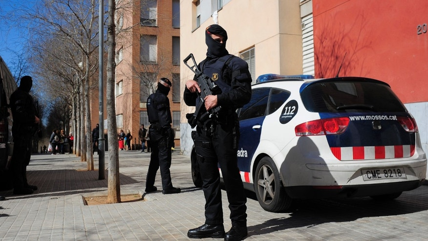 Regional police officers during a raid against jihad activity in Sabadell, near Barcelona,  Wednesday, April 8, 2015.