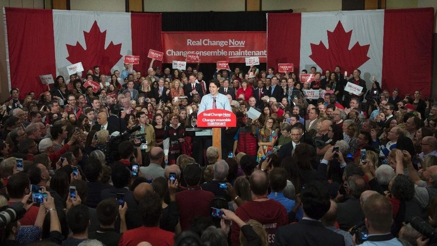 Justin Trudeau speaks to supporters at a welcome rally in Ottawa, Tuesday, Oct. 20, 2015. Trudeau, the son of late Prime Minister Pierre Trudeau, became Canada's new prime minister after beating Conservative Stephen Harper. (Adrian Wyld/The Canadian Press via AP) MANDATORY CREDIT