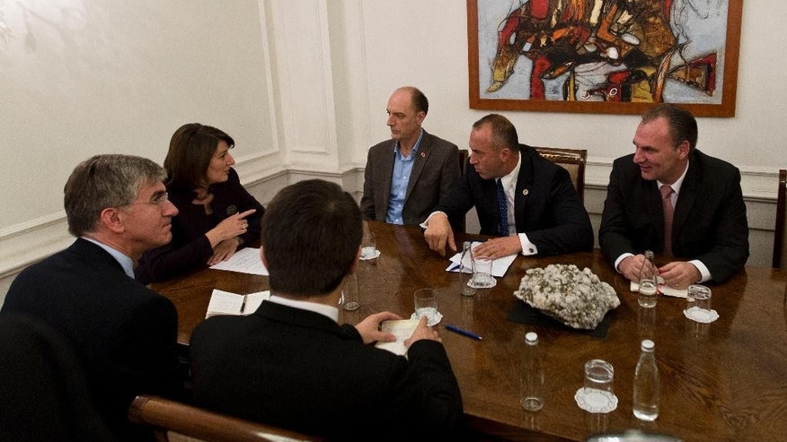 "Kosovo President Atifete Jahjaga, second left, meets opposition leaders Visar Ymeri of Vetevendosje party, background centre, Ramush Haradinaj from AAK, second right,  Fatmir Limaj from the Nisma party, right,  in a bid to resolve the political crisis in Kosovo's capital Pristina, Tuesday, Oct. 20, 2016. Kosovo's opposition warns against holding of another Parliament session unless the government backtracks from deals with Serbia and Montenegro that violate Kosovo's political and territorial integrity. After meeting Tuesday with President Atifete Jahjaga, in a mediation effort among opposing political sides, three opposition leaders said the governing coalition should not ""provoke"" with another Parliament session as that would ""escalate the situation.""  (AP Photo/Visar Kryeziu)"