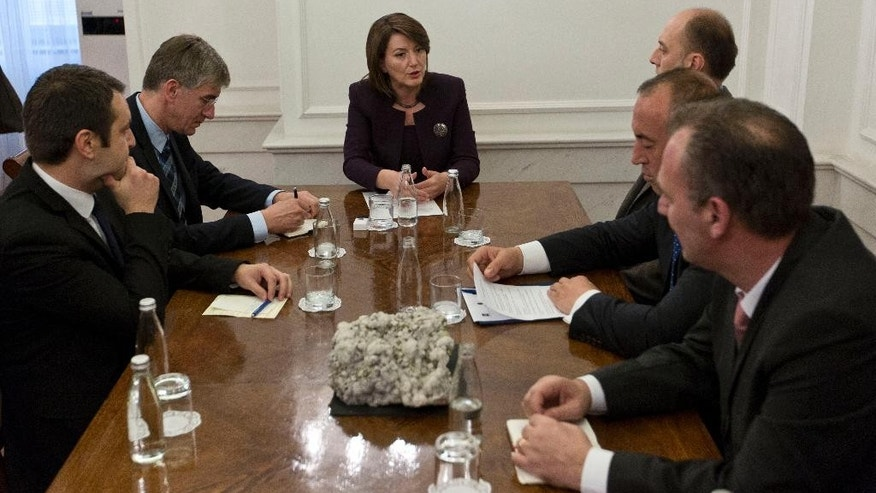 "Kosovo President Atifete Jahjaga, centre, meets opposition leaders Visar Ymeri of Vetevendosje party, obscured, background right, Ramush Haradinaj from AAK, second right,  Fatmir Limaj from the Nisma party, right,  in a bid to resolve the political crisis in Kosovo's capital Pristina, Tuesday, Oct. 20, 2016. Kosovo's opposition warns against holding of another Parliament session unless the government backtracks from deals with Serbia and Montenegro that violate Kosovo's political and territorial integrity. After meeting Tuesday with President Atifete Jahjaga, in a mediation effort among opposing political sides, three opposition leaders said the governing coalition should not ""provoke"" with another Parliament session as that would ""escalate the situation.""  (AP Photo/Visar Kryeziu)"