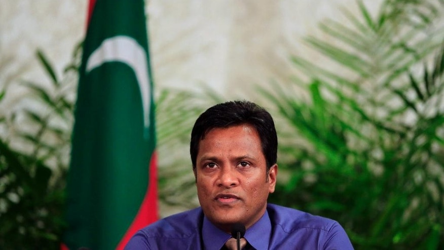 Maldives Home Minister Umar Nazeer address the press in Male, Maldives, Tuesday, Oct. 20, 2015. The government of the Maldives says the explosion on the presidential speedboat last month on Sept. 28 was caused by a device planted under the seat usually occupied by the president, who escaped unhurt because he wasn't seated there. (AP Photo/Sinan Hussain)