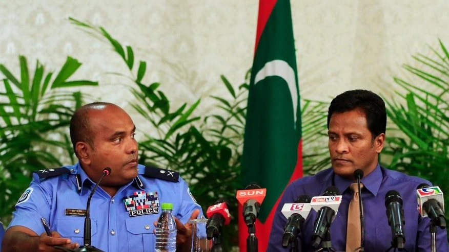 Maldives Home Minister Umar Nazeer, right, and Assistant Commissioner of Police Abdullah Nawaz attend a press conference in Male, Maldives, Tuesday, Oct. 20, 2015. The government of the Maldives says the explosion on the presidential speedboat last month on Sept. 28 was caused by a device planted under the seat usually occupied by the president, who escaped unhurt because he wasn't seated there. (AP Photo/Sinan Hussain)