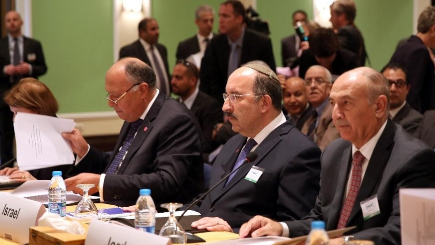 Dore Gold, Director-General of Israel's Ministry of Foreign Affairs, center, attends the opening session of the Organization for Security and Co-operation in Europe's Mediterranean Conference meeting at the Dead Sea resort town of Sweimeh, west of Amman, Jordan, Tuesday, Oct. 20, 2015. (AP Photo/Raad Adayleh)