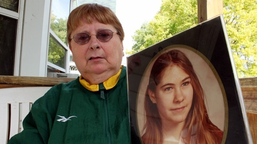 Carolyn Tousignant holds a photo of her daughter Carrie Ann Jopek, at her home on Monday, October 19, 2015, in Milwaukee. Authorities charged former neighbor and family friend Jose Ferreira with murder on Oct. 17 in the death of the 13-year-old Milwaukee girl. Police say he confessed to pushing her down a flight of stairs to her death during a party in 1982. (AP Photo/Carrie Antlfinger)