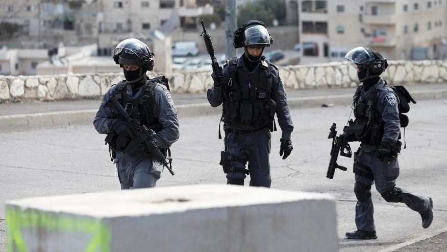 Oct. 20, 2015: Israeli riot police officers operate in the Arab neighborhood of Issawiyeh in Jerusalem.